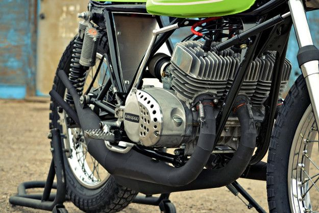 Flat-trackers and two-strokes are some of our favorite things. Combine the two, and we're hooked.All the more if the two-stroke in question is the mythical Kawasaki S1—an air-cooled triple ...